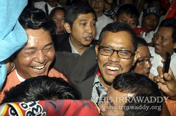 01-09-12 - Exiles return - PHOTO ? Former exile, Moe Thee zun, (centre, glasses), is given a warm greeting by supporters on arrival at Rangoon airport.