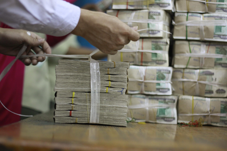 ျမစ္ဆံုေရကာတာစီမံကိန္းကို ဆန္႕က်င္ဆႏၵျပပြဲတခု (ဓာတ္ပံု - Reuters)